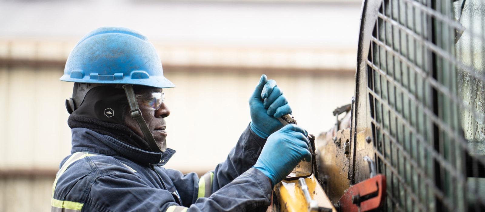 Bulk Team Member in Action Wearing Hard Hat, Safety Glasses & Gloves