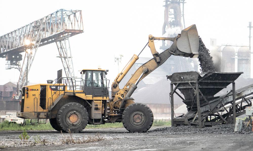 CAT Equipment Unloading Material at Job Site