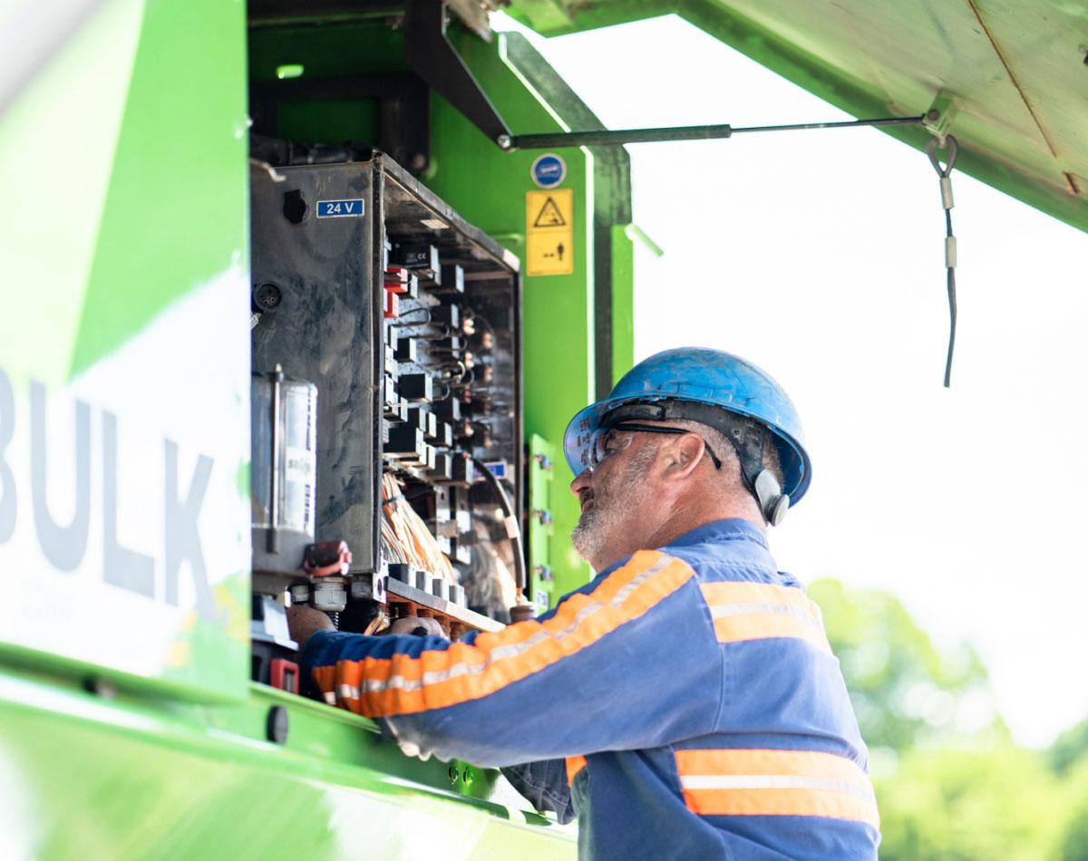Bulk Team Member Doing Equipment Maintenance + Repair