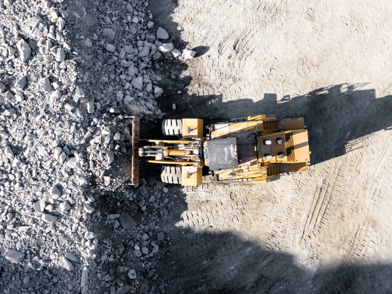 Heavy Equipment Moving Large Aggregate Material at a Quarry