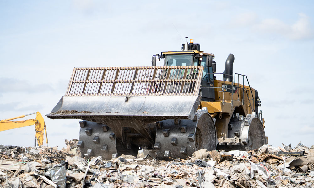 Cat® 836h Landfill Compactor Belly Guard At Job Site