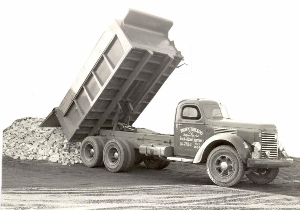 Brown Trucking Unloading Material