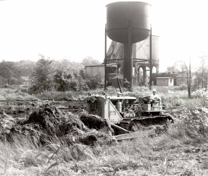 One Of Brown's Employees Operating Heavy Equipment At A Job Site Back In The Day