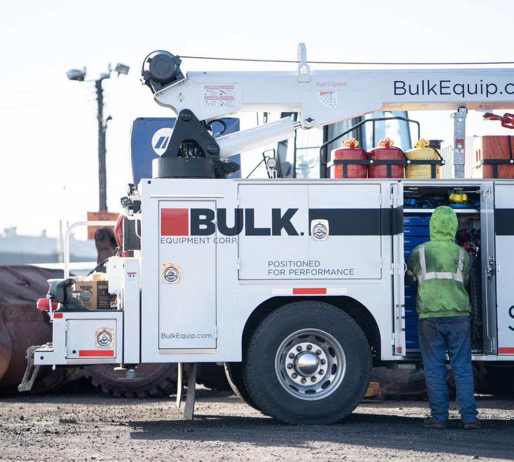 Bulk Technician Wearing Neon Safety Hoodie Working On The Field