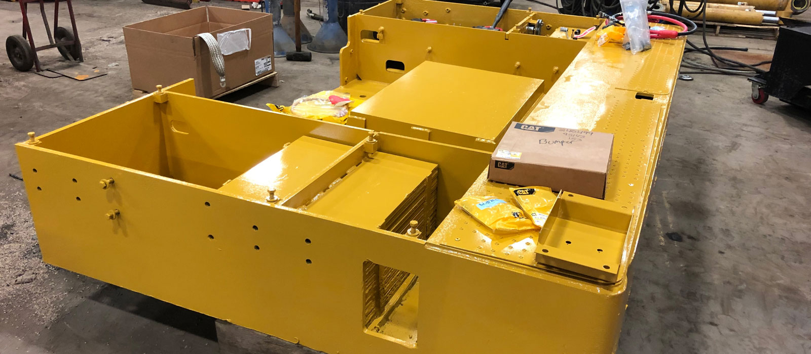 Sections Of The Heavy Machine Such As The Battery Box Are Removed, Inspected And Rebuilt At Bulk Equipment Corp.