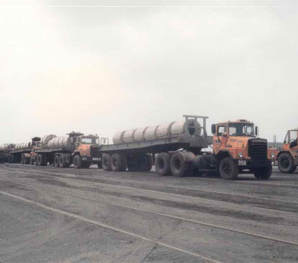 Fleet Of Trucks Hauling Coils In The Mill