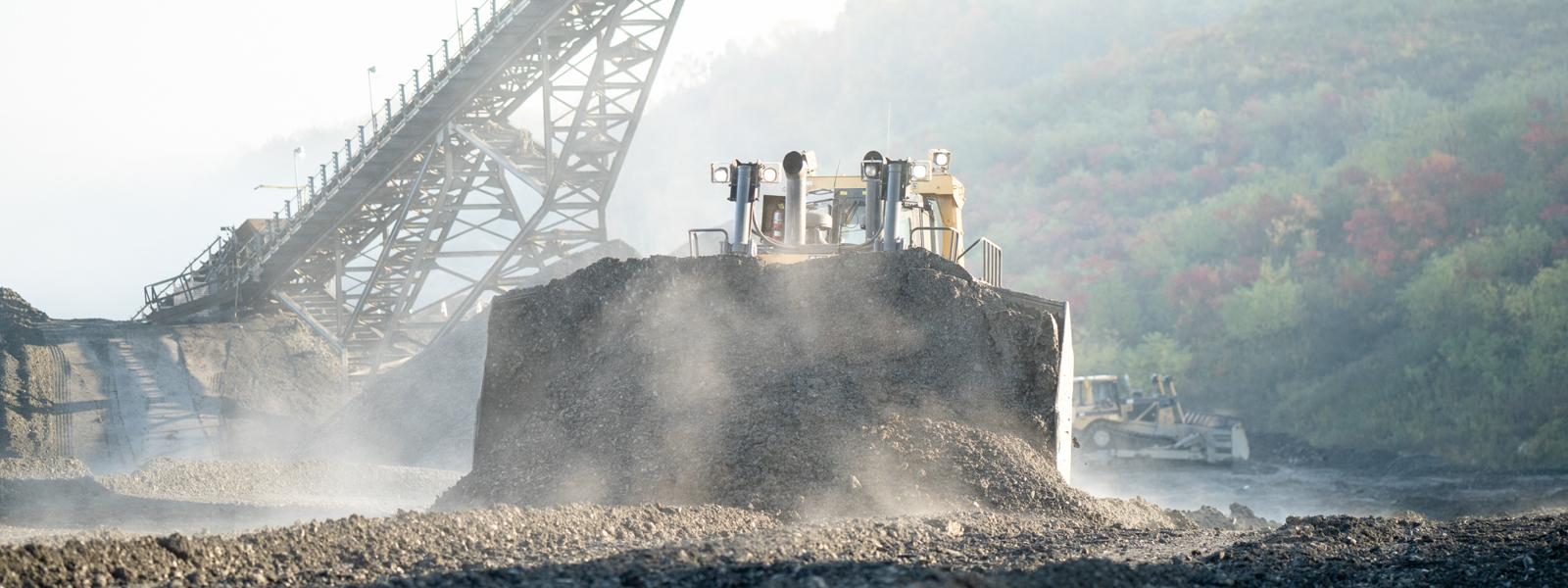 Bulldozer Moving Dirt At Mining/quarry Site