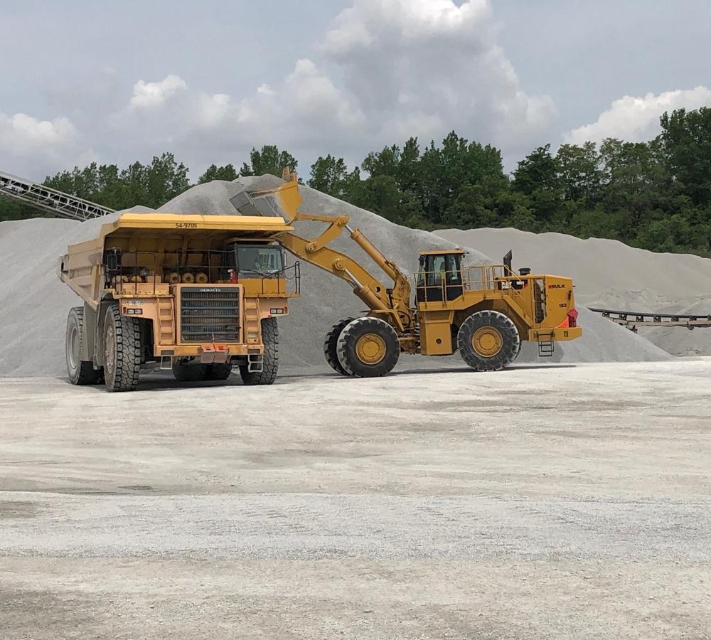 Cat® Bulldozer Rental Loading Material Onto Dump Truck