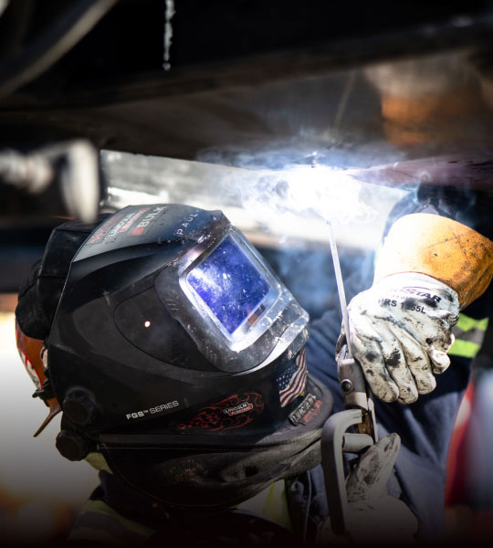 Bulk Team Member In Action Wearing PPE, Welding & Line Boring