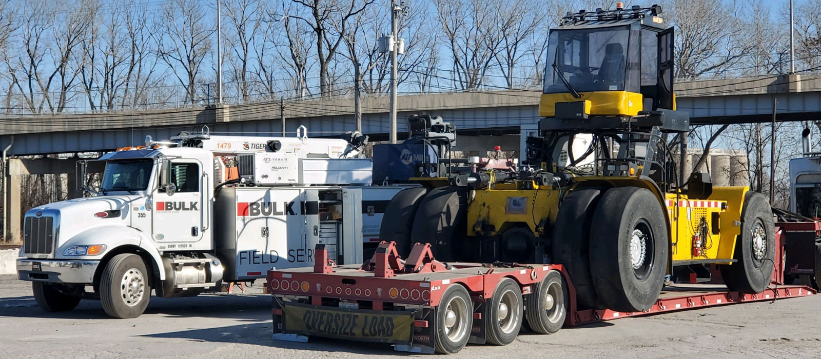Side Loader Rolling Up Onsite To Be Assembled